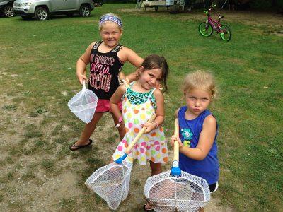 three little girls on an easter egg hunt