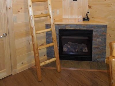 stairs to loft and fireplace
