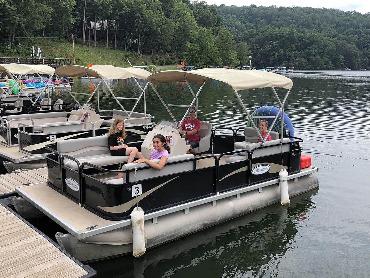 girls on pontoon boat
